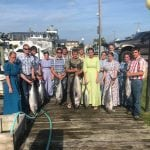 Happy group of tuna fishers